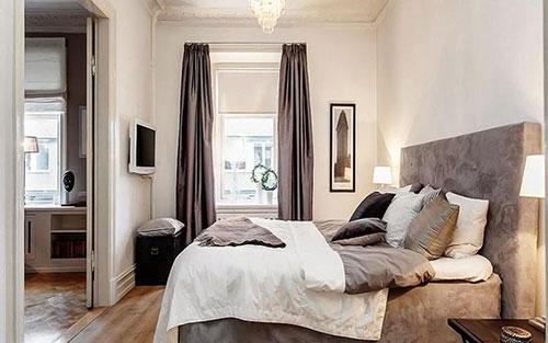 Phong thủy giường ngủ vợ chồng- cấm kỵ đặt giường ngủ đối diện cửa phòng